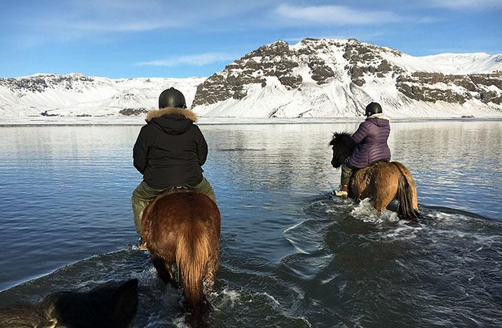 Horseback riding on a black sand beach